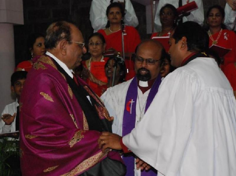 Felicitation by church for service in music.